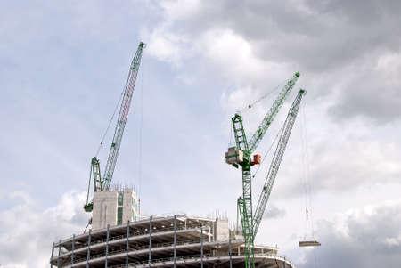 Three Heavy Lift Cranes ontop of a construction site Stock Photo - 10321601