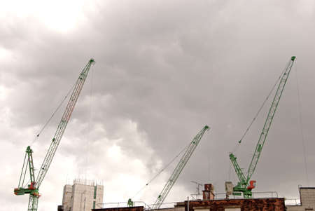 Three Heavy Lift Construction Cranes on a building site Stock Photo - 10321598