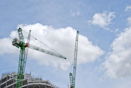 Two Green Heavy Lift Tower Cranes on a construction Site Stock Photo - 10321597