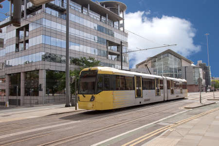 A Modern Yellow Tram on an English City Street Stock Photo - 10321608