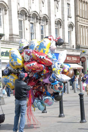 Man selling balloons on a shopping precinct Stock Photo - 10331691