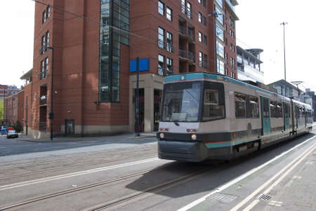 A Modern Green and White Tram on a city Street Stock Photo - 10331692