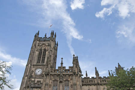 The Clocktower of an English Cathedral Stock Photo