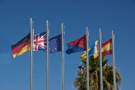 The Flags of Germany,United Kingdom,European Union,Lanzarote,Canary Islands and Spain under a blue sky photo