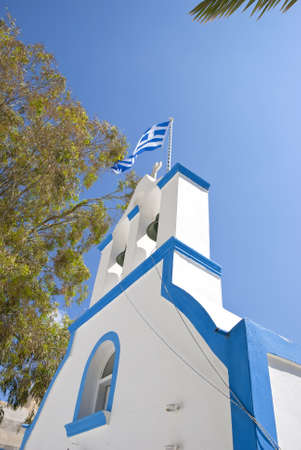 Greek Orthodox Chapel and Bell Tower with Greek Flag Flying Stock Photo
