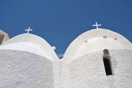 The Twin Domes of a medieval Greek Chapel in Santorini Greece photo