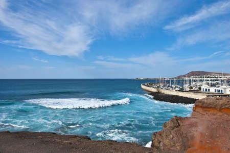 The Atlantic breaking on the coastline near Playa Blanca Lanzarote Stock Photo - 17102998
