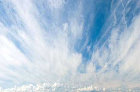 stratus: Cirrus or Mares Tails Clouds with Cumulus Clouds in background Stock Photo