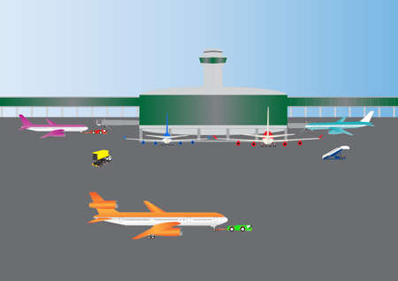airliner: An Airport Building with Airliners at Gates and Airliner being towed to runway