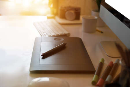 Closeup of a graphic designer's desk. workspace creative digital tablet and modern desktop computer. Stockfoto