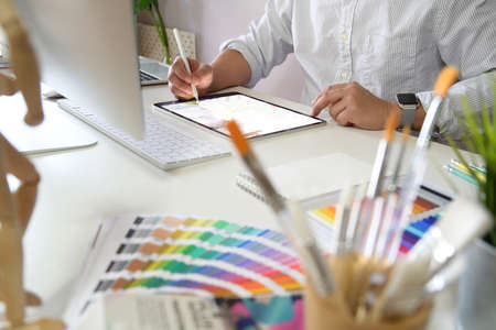 Young Artist and graphic designer at studio workspace