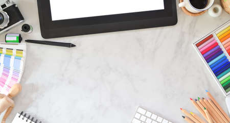 Top view of passionate graphic designer workplace with stationery on marble desk background
