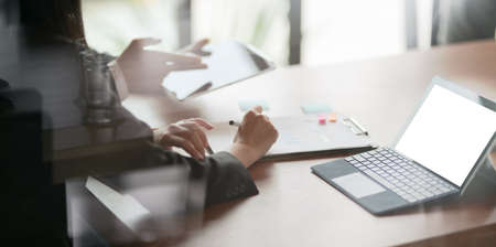 Close-up view of successful businesspeople working together in modern office room