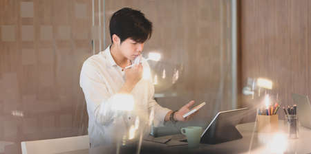 Young businessman working his project with laptop computer in modern workplace