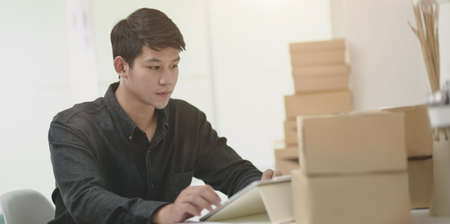 Businessman preparing shipment for deliver to customer in the office room.