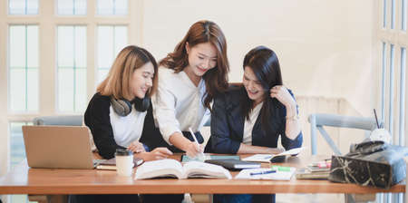 Professional female freelancer presenting her idea to her team members in modern workplace Stock Photo