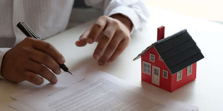 Property real estate concept : customer signing contract about home loan agreement for new house