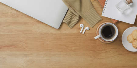 Top view of comfortable workspace with laptop computer and office supplies on wooden desk background  Stockfoto