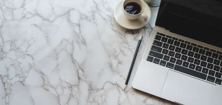 Top view of modern stylish workplace with laptop computer and coffee cup on marble table background 스톡 콘텐츠 - 133666881