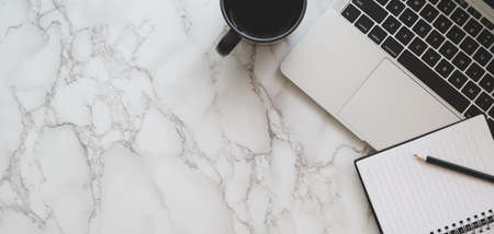 Top view of stylish workspace with laptop computer and notebook with coffee cup on marble table background 스톡 콘텐츠 - 133666882