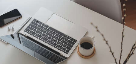 Cropped shot of comfortable workspace with laptop computer and office supplies on white wooden table 스톡 콘텐츠