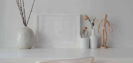 Minimal room with mock up frame with ceramic decorations on white table with white wall background 스톡 콘텐츠 - 133667569