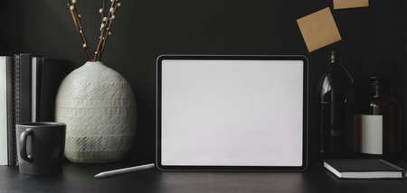 Trendy office room with blank screen digital tablet with office supplies and decorations 스톡 콘텐츠