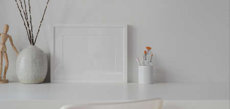 Minimal room with mock up frame with ceramic decorations on white table with white wall background