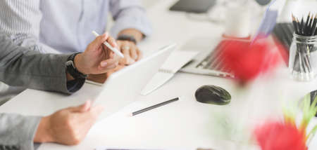 Cropped shot of professional business team working on their strategy tighter in modern office room