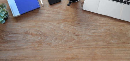Top view of comfortable workplace with office supplies and copy space on wooden table  스톡 콘텐츠