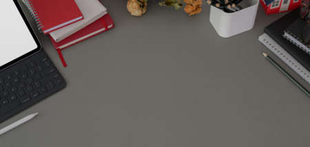 Top view of dark modern workplace with copy space and office supplies on dark grey desk background  스톡 콘텐츠
