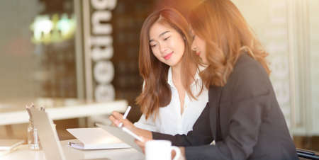 Young professional businesswoman working on their marketing project together in modern office room  스톡 콘텐츠