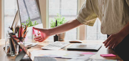 Cropped shot of young graphic designer working on their concept together in comfortable workplace Stock Photo