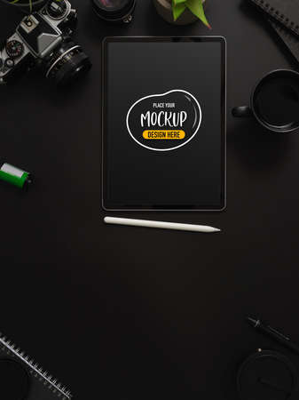 Top view of modern photographer workspace with mock up tablet and office supplies