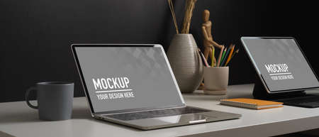 Close up view of home office desk with tablet, books, stationery and decorations, include clipping path