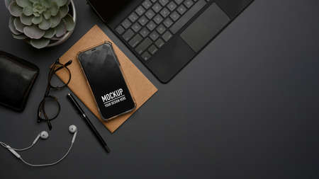 Top view of workspace with smartphone, keyboard, stationery and copy space on the table, clipping path