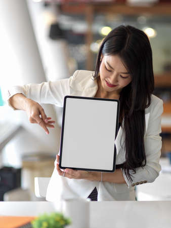 Cropped shot of businesswoman presenting mock up digital tablet include clipping path screen