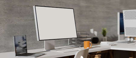 Side view of comfortable office desk with computer monitor, laptop and office supplies on the table, 3D rendering, 3D illustration