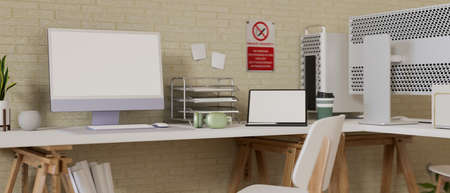 Comfortable office desk with computer, laptop, office supplies, decorations and no smoking sign on the wall, 3D rendering, 3D illustration 版權商用圖片