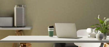 3D rendering, simple portable workspace with laptop, supplies, tumbler, plant pot and copy space on the table, 3D illustration