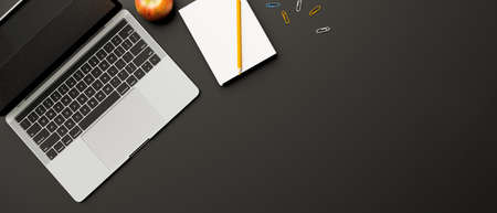 Top view, 3D rendering, dark study table with laptop, stationery, apple and copy space on black table, 3D illustration 版權商用圖片