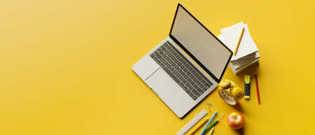 Top view, 3D rendering, stylish workspace with laptop, stationery, school elements and copy space on yellow background, 3D illustration 版權商用圖片