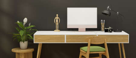 Home office desk with computer, stationery, camera and decorations in grey wall room, 3D rendering, 3D illustration