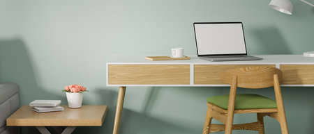 Laptop  with mock-up screen on wooden desk in stylish home office room, 3D rendering, 3D illustration