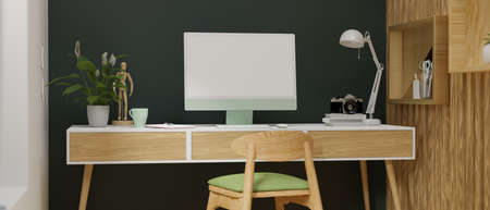 Computer monitor with mock-up screen on wooden desk in stylish home office room, 3D rendering, 3D illustration 版權商用圖片