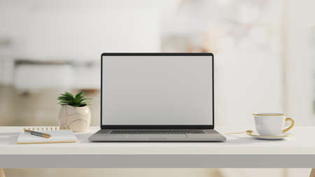 Computer laptop with mock-up screen on white table with stationery, cup and plant pot, 3D rendering, 3D illustration 版權商用圖片