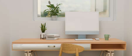 Computer device with mock-up screen on wooden desk with books and plant pot in minimal home office, 3D rendering, 3D illustration