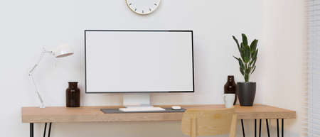 Computer monitor with mock-up screen on wooden table with decorations in minimal room, 3D rendering, 3D illustration