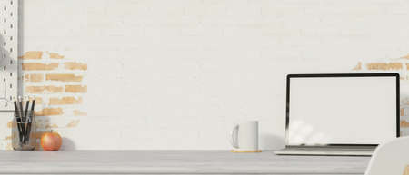 Simple workspace with laptop, mug, pencils and copy space on the desk with brick wall background, 3D render, 3D illustration