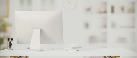 Computer, stationery and copy space on the table with blurred home office background, 3D rendering, 3D illustration